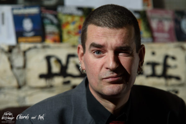"Chords And Ink - fantastic musicians talk about their favourite tattoo and the story behind it. Chords and Ink 15 with Toschi of Austrian ""Psycho-Pogo-Pop"" / Punk Rock band KRIEG DEN PALÄSTEN. www.fb.com/wetphoto | www.wet-photo.at NO USE WITHOUT PRIOR WRITTEN PERMISSION // KEINE VERWENDUNG OHNE VORHERIGE SCHRIFTLICHE ERLAUBNIS."